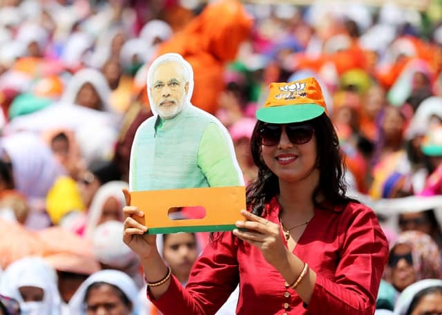 Woman Holds Narendra Modi Cutout