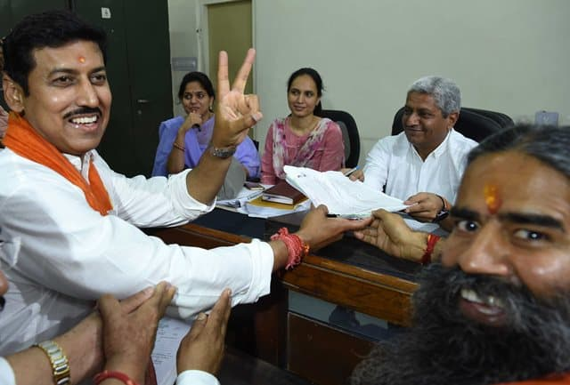 BJP Leader Rathore With Baba Ramdev