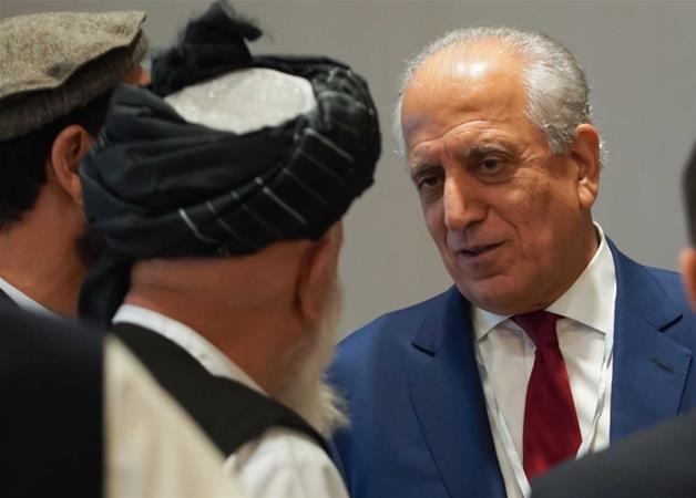 Zalmay Khalilzad with Taliban representatives